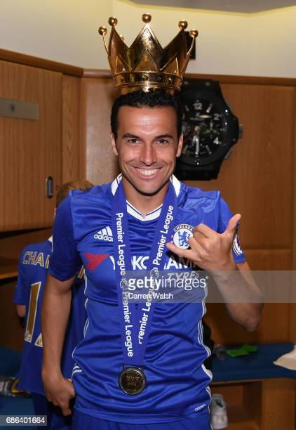 Pedro of Chelsea celebrates in the changing room after the Premier League match between Chelsea and Sunderland at Stamford Bridge on May 21 2017 in...