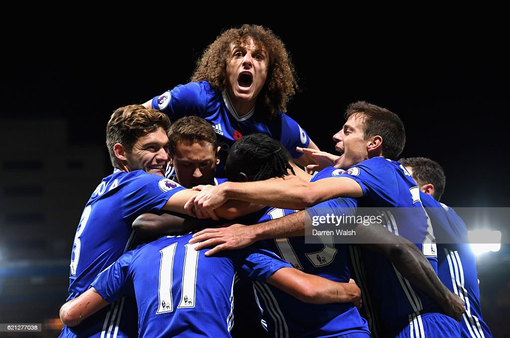 Pedro of Chelsea celebrates scoring his sides fifth goal with his Chelsea team mates during the Premier League match between Chelsea and Everton at Stamford Bridge on November 5, 2016 in London, England.