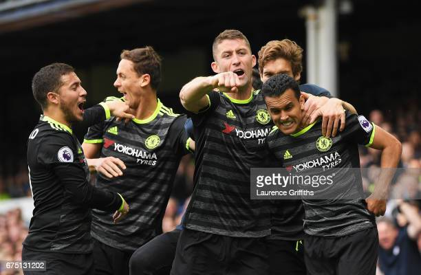 Pedro of Chelsea celebrates scoring his sides first goal with Gary Cahill of Chelsea during the Premier League match between Everton and Chelsea at...