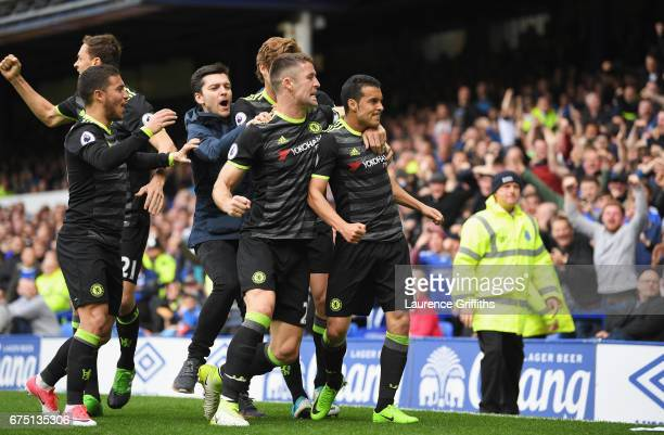 Pedro of Chelsea celebrates scoring his sides first goal with his Chelsea team mates during the Premier League match between Everton and Chelsea at...
