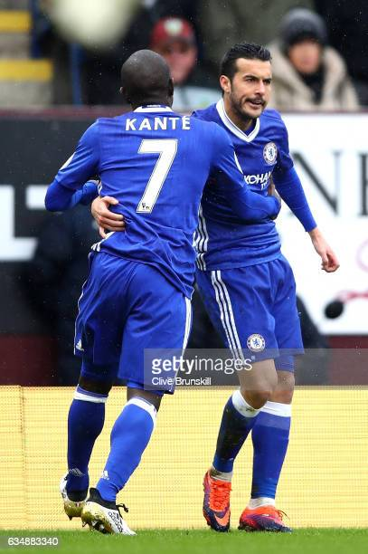 Pedro of Chelsea celebrates scoring his sides first goal with N'Golo Kante of Chelsea during the Premier League match between Burnley and Chelsea at...