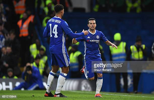 Pedro of Chelsea celebrates scoring his sides first goal with Ruben LoftusCheek of Chelsea during The Emirates FA Cup Third Round match between...