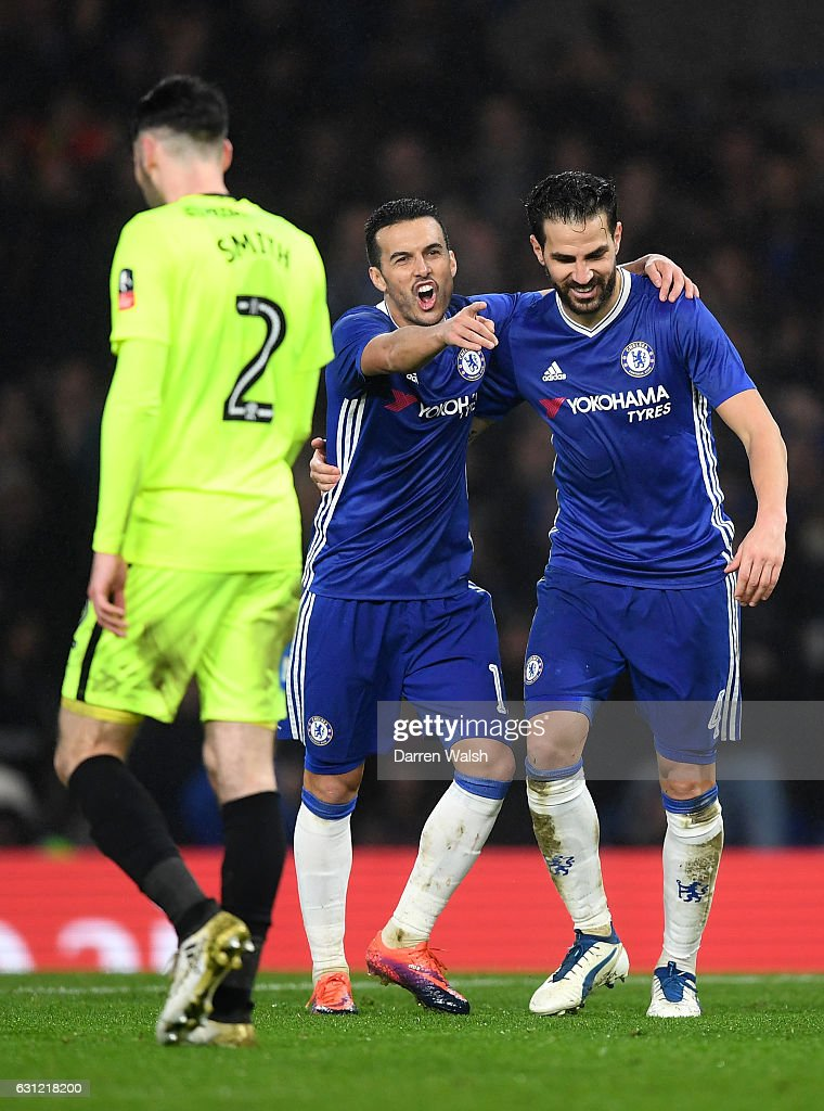 Pedro of Chelsea (L) celebrates scoring his sides fourth goal with Cesc Fabregas of Chelsea (R) during The Emirates FA Cup Third Round match between Chelsea and Peterborough United at Stamford Bridge on January 8, 2017 in London, England.