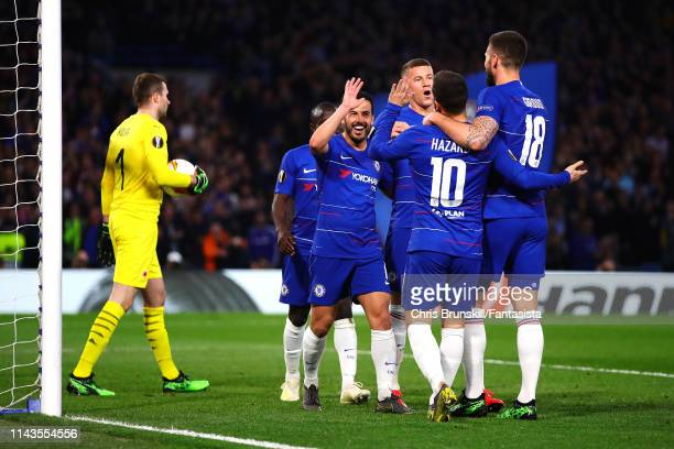 Pedro of Chelsea celebrates scoring his side's second goal with his teammates during the UEFA Europa League Quarter Final Second Leg match between...
