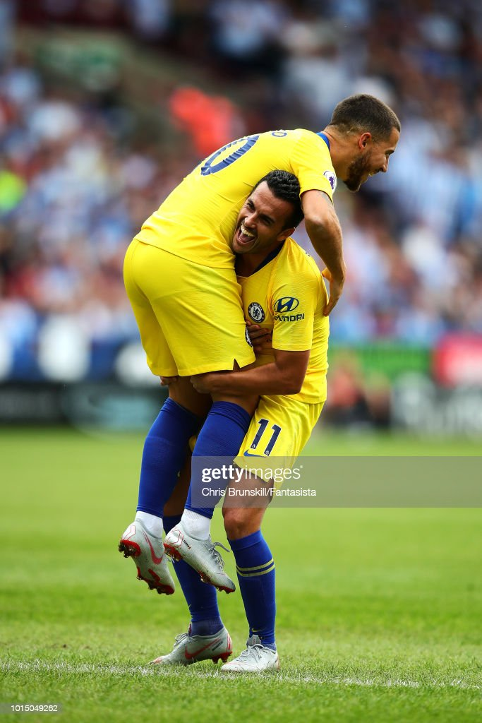Pedro of Chelsea celebrates scoring his side's third goal with team-mate Eden Hazard during the Premier League match between Huddersfield Town and Chelsea FC at John Smith's Stadium on August 11, 2018 in Huddersfield, United Kingdom.