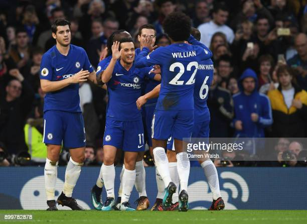 Pedro of Chelsea celebrates scoring his sides third goal with team mates during the Premier League match between Chelsea and Stoke City at Stamford...