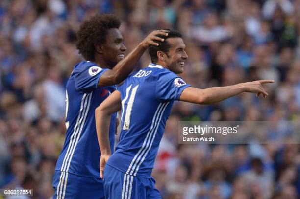 Pedro of Chelsea celebrates scoring his sides third goal with Willian of Chelsea during the Premier League match between Chelsea and Sunderland at...