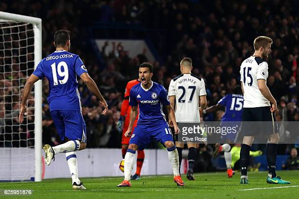 Pedro of Chelsea celebrates scoring his team's first goal with his team mate Diego Costa during the Premier League match between Chelsea and...