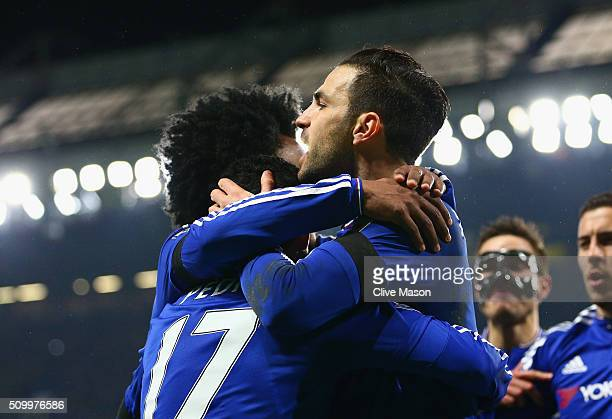 Pedro of Chelsea celebrates scoring his team's second goal with his team mate Cesc Fabregas during the Barclays Premier League match between Chelsea...