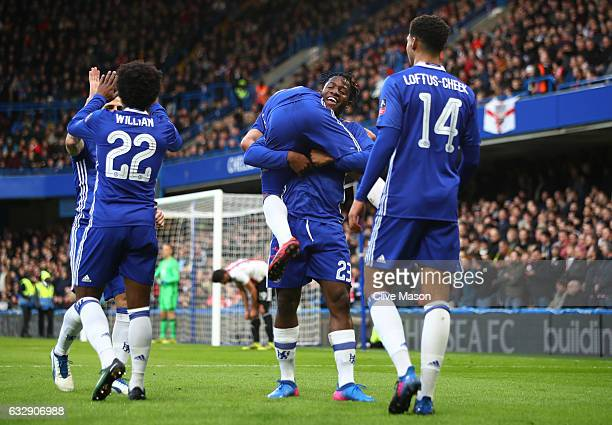 Pedro of Chelsea celebrates scoring his team's second goal with his team mate Michy Batshuayi during the Emirates FA Cup Fourth Round match between...