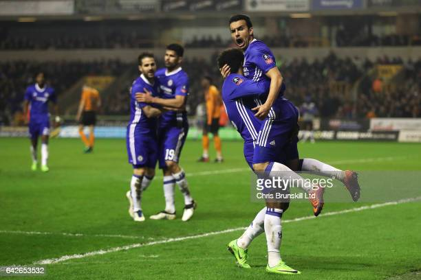 Pedro of Chelsea celebrates scoring the opening goal with teammate Willian during the Emirates FA Cup Fifth Round match between Wolverhampton...