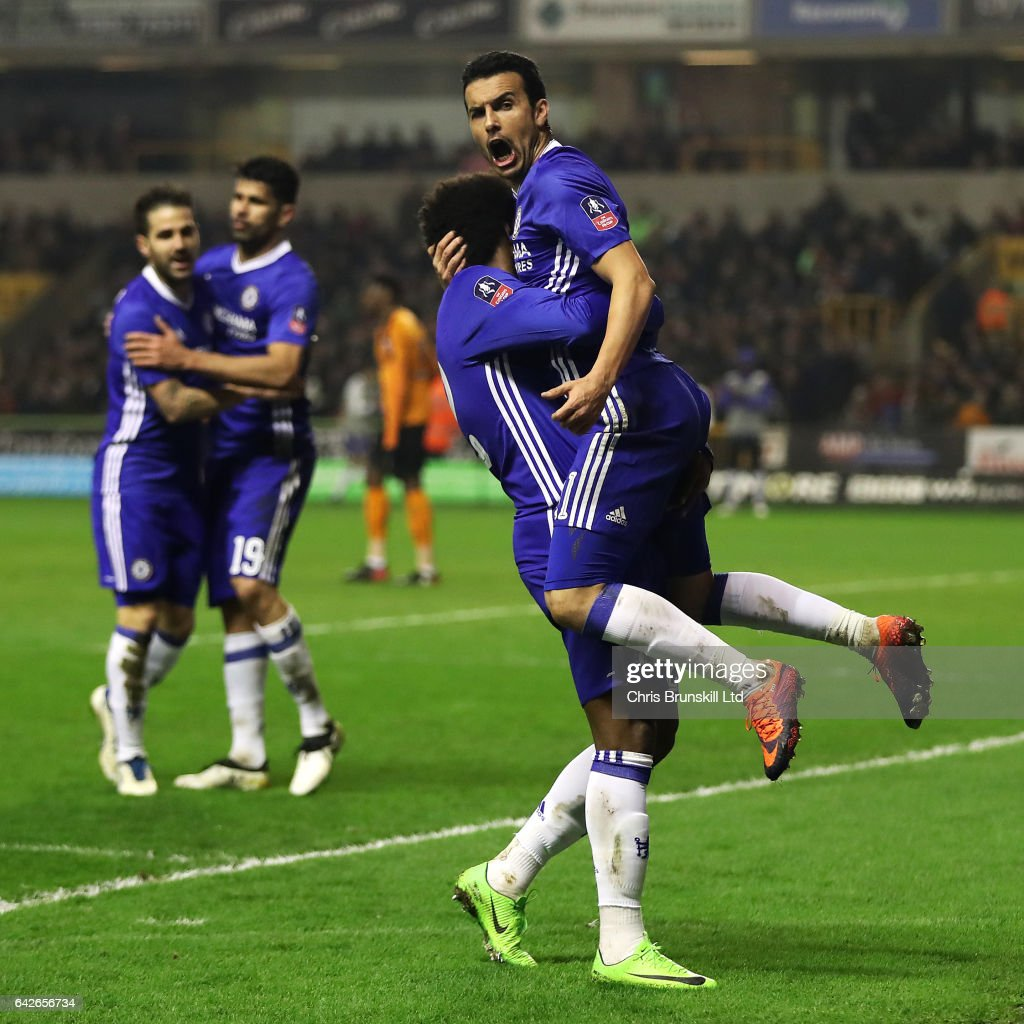Pedro of Chelsea celebrates scoring the opening goal with team-mate Willian during the Emirates FA Cup Fifth Round match between Wolverhampton Wanderers and Chelsea at Molineux on February 18, 2017 in Wolverhampton, England.