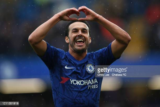 Pedro of Chelsea celebrates scoring their first goal during the Premier League match between Chelsea FC and Everton FC at Stamford Bridge on March...