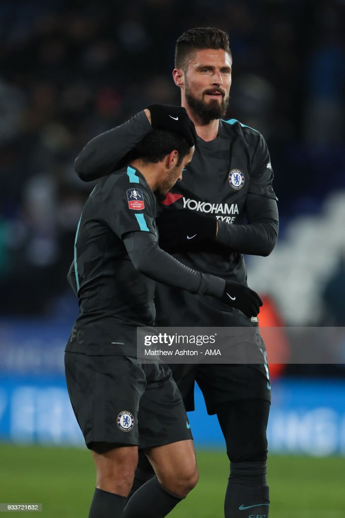 Pedro of Chelsea celebrates victory with Olivier Giroud during the FA Cup Quarter Final match between Leicester City and Chelsea at The King Power Stadium on March 18, 2018 in Leicester, England.