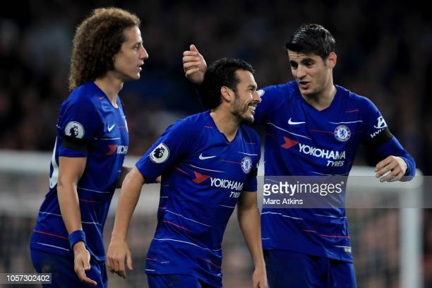 Pedro of Chelsea celebrates with Alvaro Morata and David Luiz during the Premier League match between Chelsea FC and Crystal Palace at Stamford...
