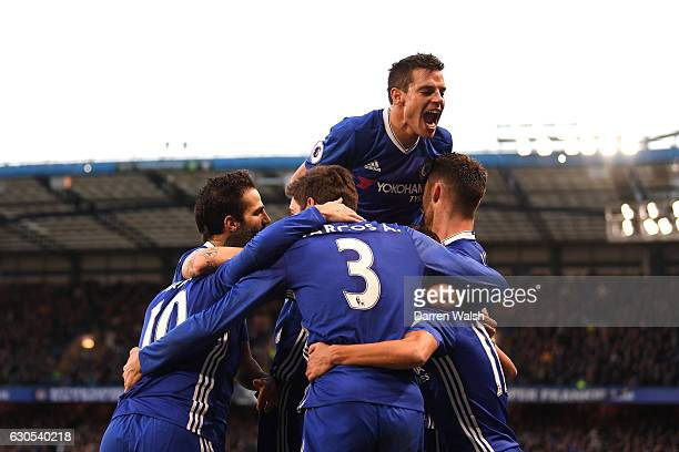 Pedro of Chelsea celebrates with Cesar Azpilicueta of Chelsea and team mates after scoring his sides first goal during the Premier League match...