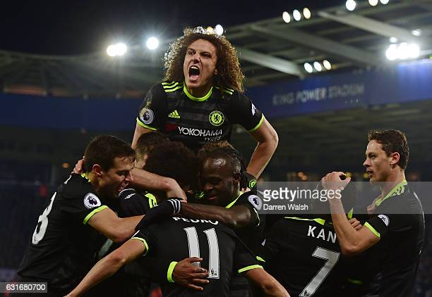 Pedro of Chelsea celebrates with David Luiz and teammates after scoring his team's third goal during the Premier League match between Leicester City...