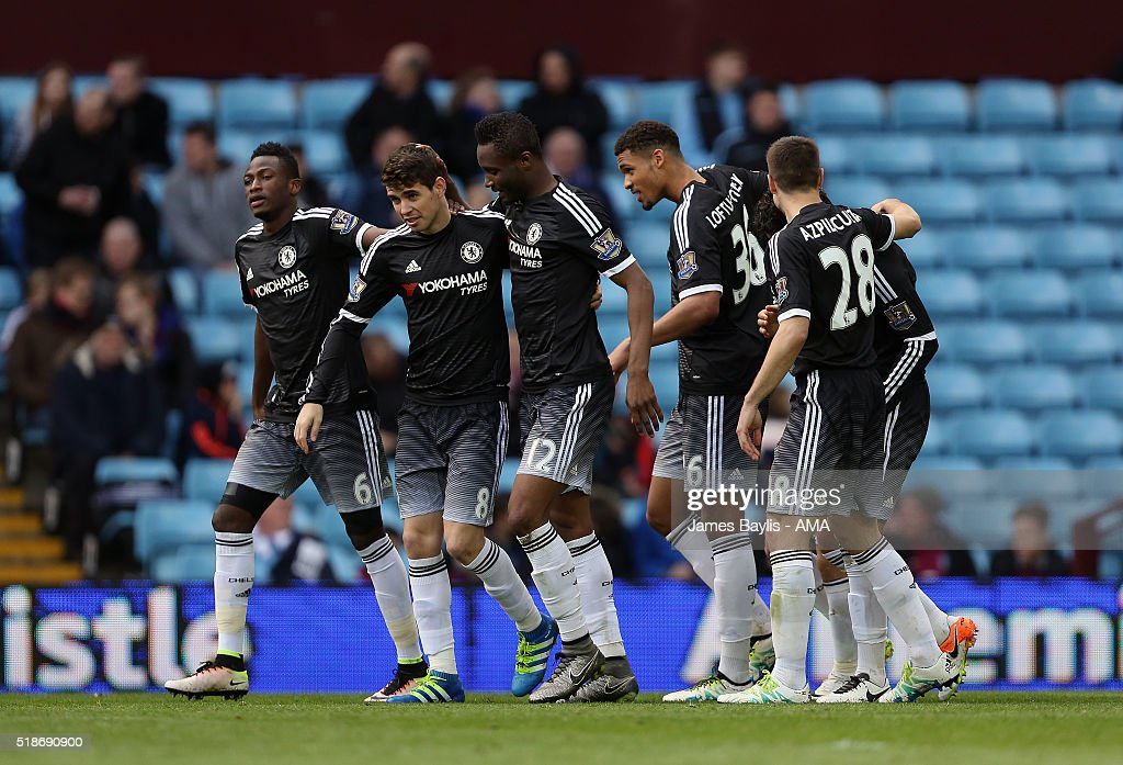 Pedro of Chelsea celebrates with his team-mates after scoring a goal to make it 0-3 during the Barclays Premier League match between Aston Villa and Chelsea at Villa Park on April 2, 2016 in Birmingham, England.
