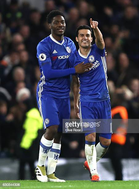 Pedro of Chelsea celebrates with Ola Aina of Chelsea after scoring his second and his sides third during the Premier League match between Chelsea and...