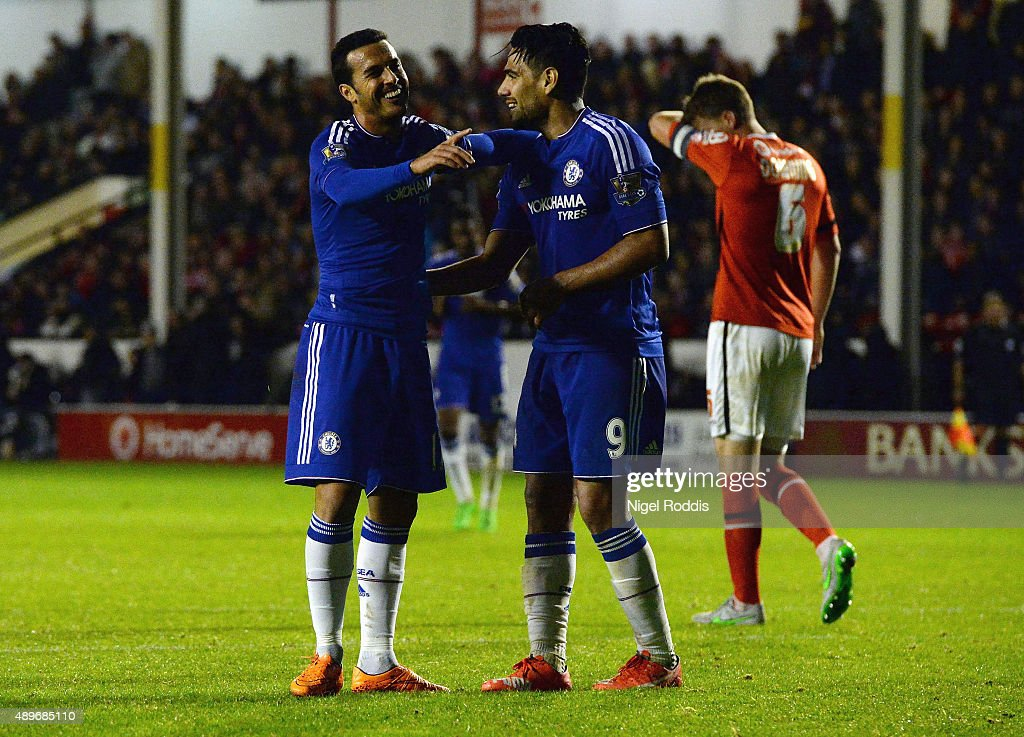 Pedro of Chelsea (L) celebrates with Radamel Falcao Garcia as he scores their fourth goal during the Capital One Cup third round match between Walsall and Chelsea at Banks's Stadium on September 23, 2015 in Walsall, England.