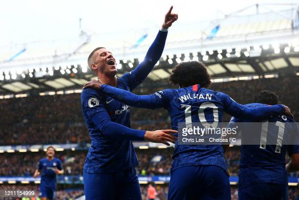 Pedro of Chelsea celebrates with Ross Barkley and Willian after scoring his team's second goal during the Premier League match between Chelsea FC and...