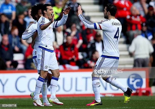 Pedro of Chelsea celebrates with Sesc Fabregas of Chelsea after scoring the opening goal during the Barclays Premier League match between AFC...