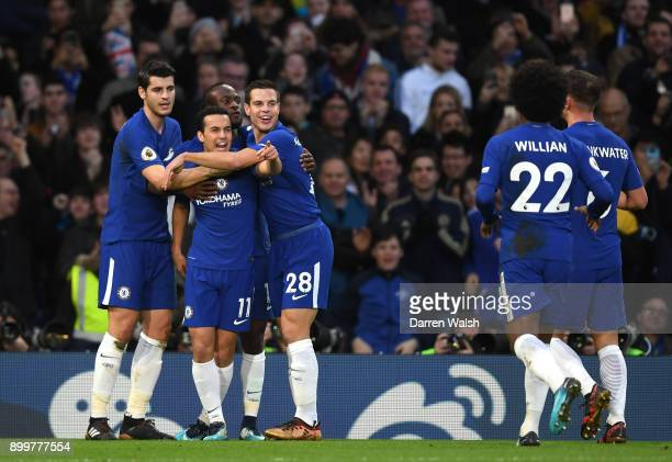 Pedro of Chelsea celebrates with team mates after scoring his sides third goal during the Premier League match between Chelsea and Stoke City at...