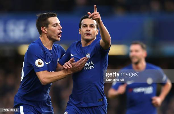 Pedro of Chelsea celebrates with teammate Cesar Azpilicueta after scoring his sides third goal during the Premier League match between Chelsea and...
