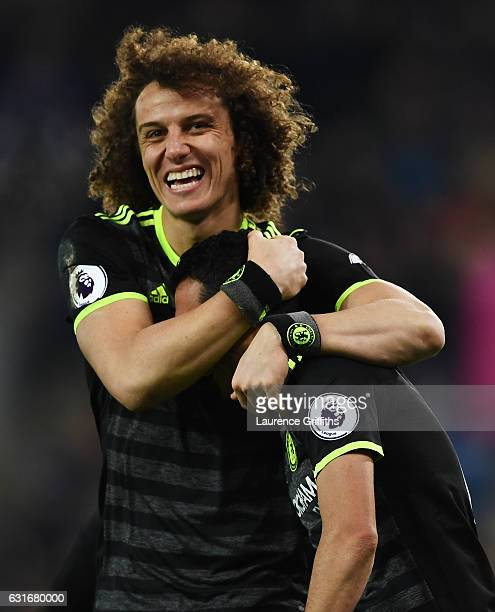 Pedro of Chelsea celebrates with teammate David Luiz after scoring his team's third goal during the Premier League match between Leicester City and...