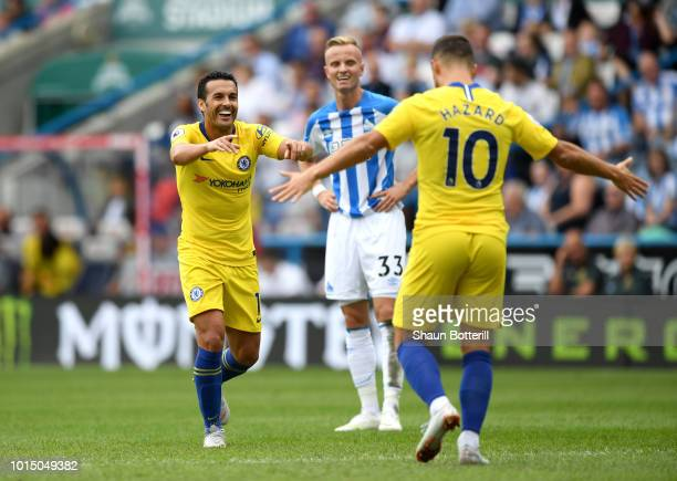 Pedro of Chelsea celebrates with teammate Eden Hazard after scoring his team's third goal during the Premier League match between Huddersfield Town...
