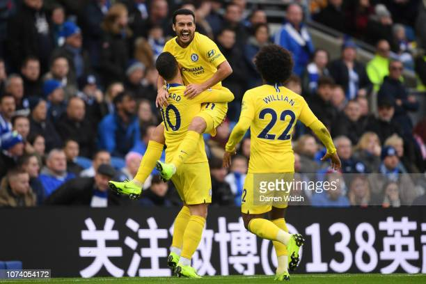 Pedro of Chelsea celebrates with teammate Eden Hazard and Willian after scoring his team's first goal during the Premier League match between...