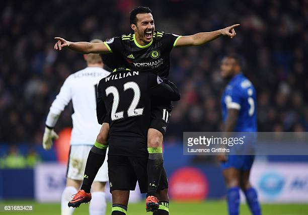 Pedro of Chelsea celebrates with teammate Willian of Chelsea after scoring their team's third goal during the Premier League match between Leicester...