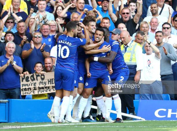 Pedro of Chelsea celebrates with teammates after scoring his team's first goal during the Premier League match between Chelsea FC and AFC Bournemouth...