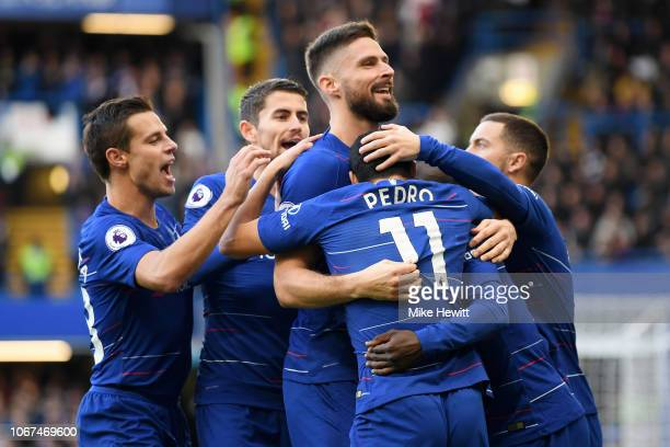 Pedro of Chelsea celebrates with teammates after scoring his team's first goal during the Premier League match between Chelsea FC and Fulham FC at...