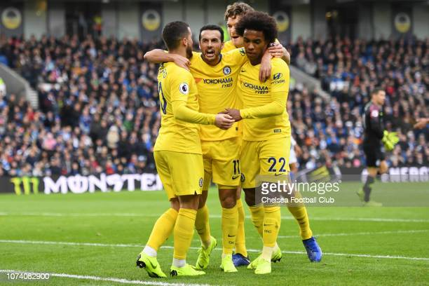 Pedro of Chelsea celebrates with teammates Eden Hazard Willian and Marcos Alonso after scoring his team's first goal during the Premier League match...