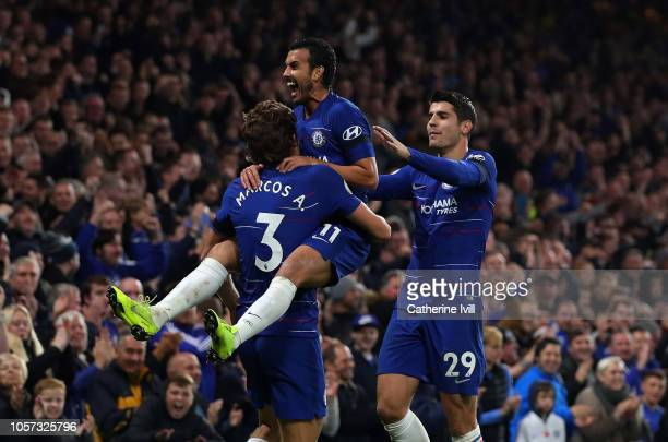 Pedro of Chelsea celebrates with teammates Marcos Alonso and Alvaro Morata after scoring his team's third goal during the Premier League match...