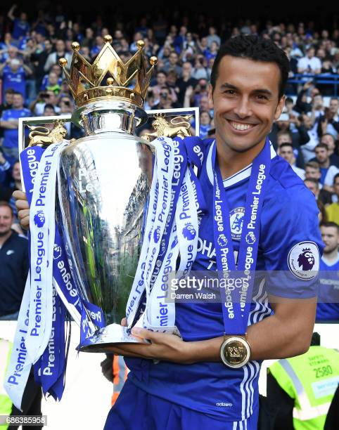 Pedro of Chelsea celebrates with the Premier League Trophy after the Premier League match between Chelsea and Sunderland at Stamford Bridge on May 21...
