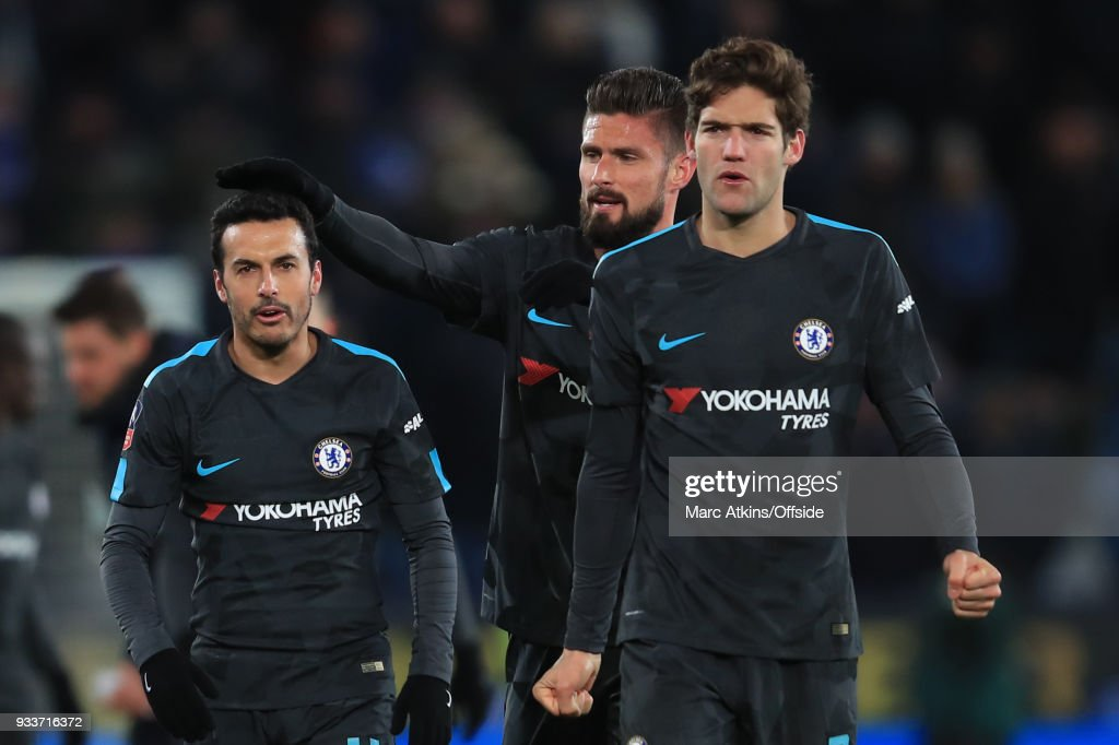 Pedro of Chelsea congratulated by team mates Olivier Giroud and Marcos Alonso during the Emirates FA Cup Quarter Final match between Leicester City and Chelsea at The King Power Stadium on March 18, 2018 in Leicester, England.