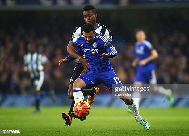Pedro of Chelsea controls the ball under pressure of Rolando Aarons of Newcastle United during the Barclays Premier League match between Chelsea and...