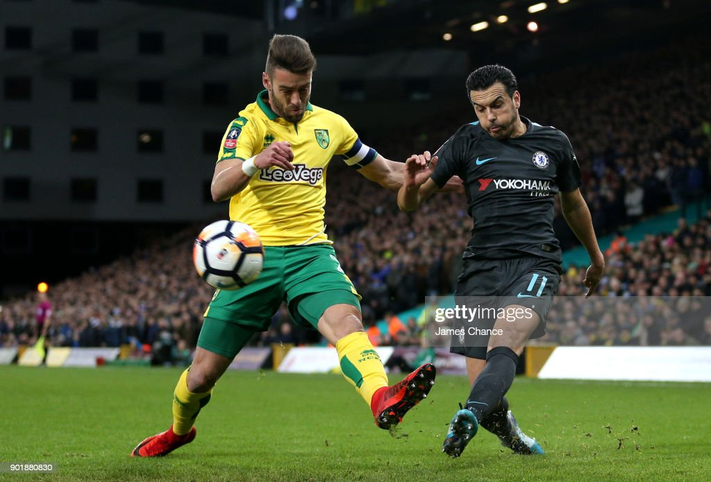 Pedro of Chelsea crosses as he is challenged by Ivo Pinto of Norwich City during The Emirates FA Cup Third Round match between Norwich City and Chelsea at Carrow Road on January 6, 2018 in Norwich, England.