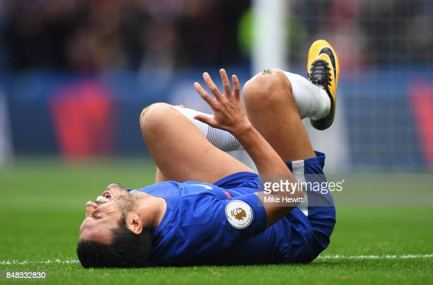 Pedro of Chelsea goes down injured during the Premier League match between Chelsea and Arsenal at Stamford Bridge on September 17 2017 in London...