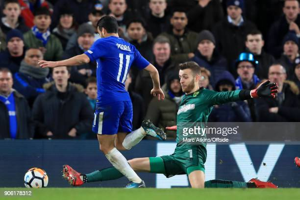 Pedro of Chelsea goes to ground as Norwich goalkeeper Angus Gunn slides out to challenge during The Emirates FA Cup Third Round Replay match between...