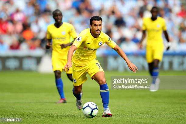 Pedro of Chelsea in action during the Premier League match between Huddersfield Town and Chelsea FC at John Smith's Stadium on August 11 2018 in...