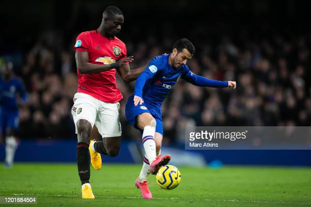 Pedro of Chelsea in action with Eric Bailly of Manchester United during the Premier League match between Chelsea FC and Manchester United at Stamford...