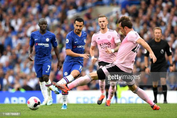 Pedro of Chelsea is challenged by Christian Fuchs of Leicester City during the Premier League match between Chelsea FC and Leicester City at Stamford...