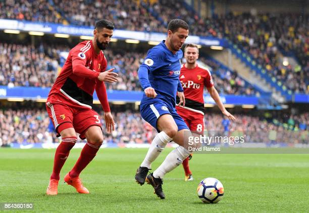 Pedro of Chelsea is challenged by Miguel Britos of Watford and Tom Cleverley of Watford during the Premier League match between Chelsea and Watford...