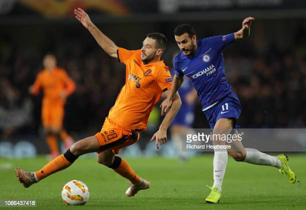 Pedro of Chelsea is challenged by Vierinha of PAOK FC during the UEFA Europa League Group L match between Chelsea and PAOK at Stamford Bridge on...