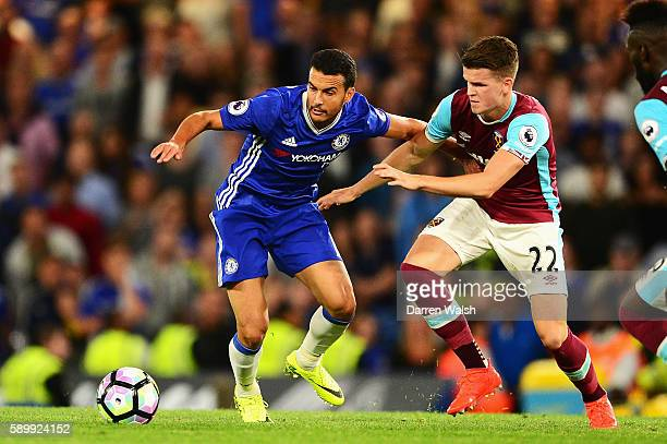 Pedro of Chelsea is closed down by Sam Byram of West Ham United during the Premier League match between Chelsea and West Ham United at Stamford...