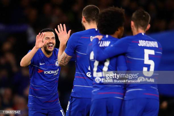 Pedro of Chelsea is congratulated by his teammates after scoring the opening goal during the UEFA Europa League Round of 16 First Leg match between...