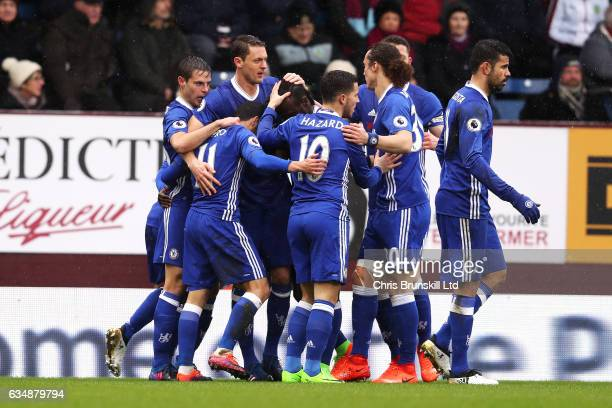 Pedro of Chelsea is congratulated by his teammates after scoring the opening goal during the Premier League match between Burnley and Chelsea at Turf...